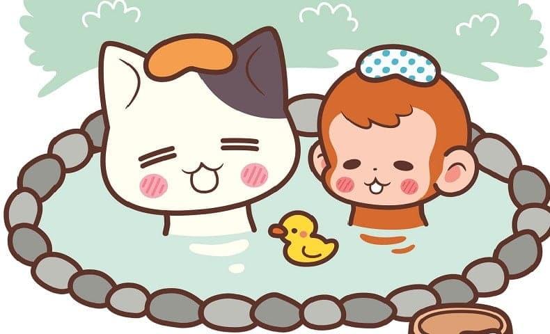 猫と猿が、温泉にはいっているイラスト
